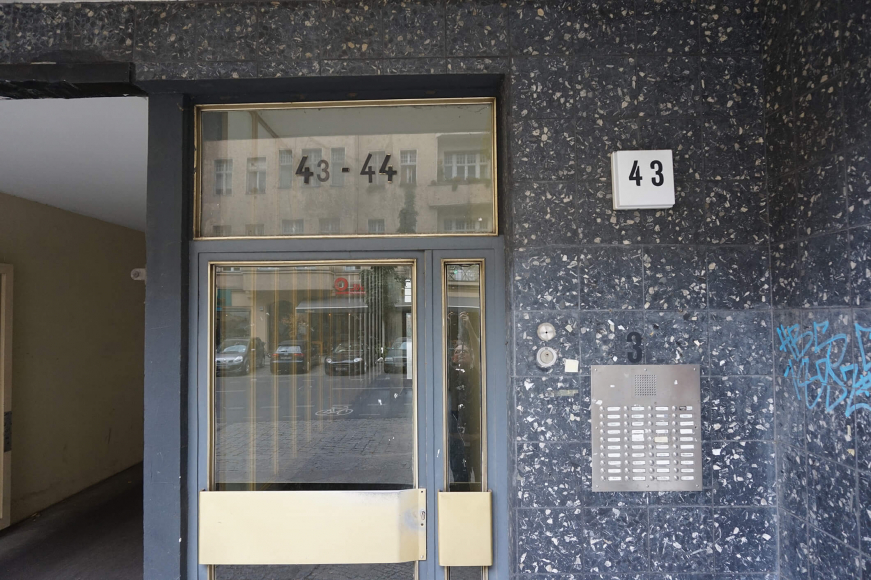 "Color photo: Glass front door with the number ""43"""