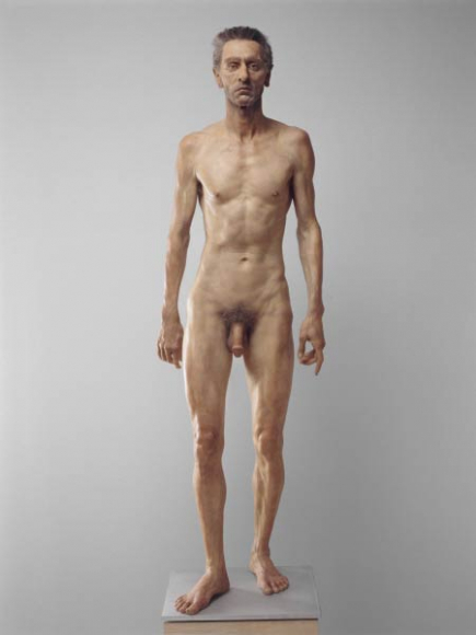 Sculpture of a standing naked skinny older man with a circumcised penis