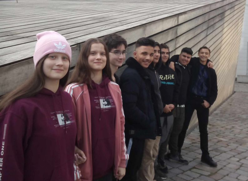 Eight young adults outside the W. Michael Blumenthal Academy of the Jewish Museum Berlin