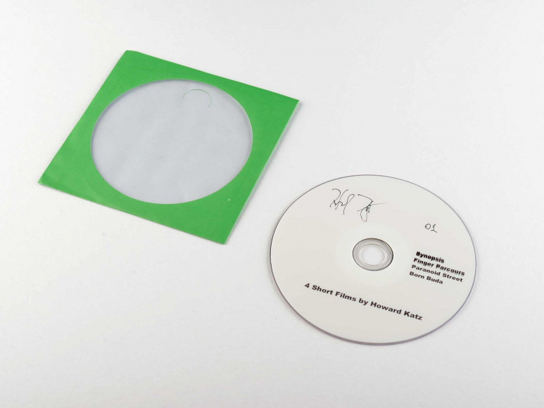 White DVD with bright green paper DVD case