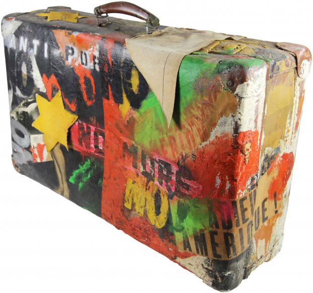 An old suitcase is covered in colorful paint and various aggressive words and phrases with yellow patches of the star of david
