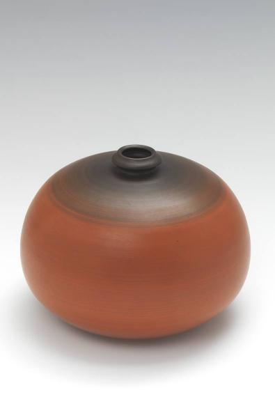 Orange-braune, runde Vase