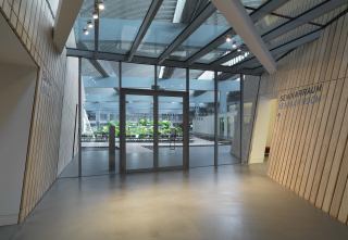 Entrance of the Academy Garden, the green plants can be seen through the glass doors and windows