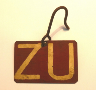 Metal sign with the letters ZU