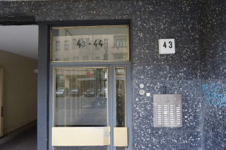 """Color photo: Glass front door with the number """"43"""""""