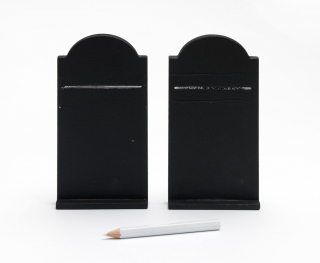 "Two ""tablets of commandments"" with curved tops made of a medium-density fiberboard and painted with blackboard paint behind a white chalk pencil"