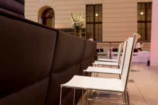 Chairs at a counter in the glass courtyard of the JMB