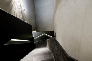 A downwards view of the winding staircase leading to the permanent exhibit