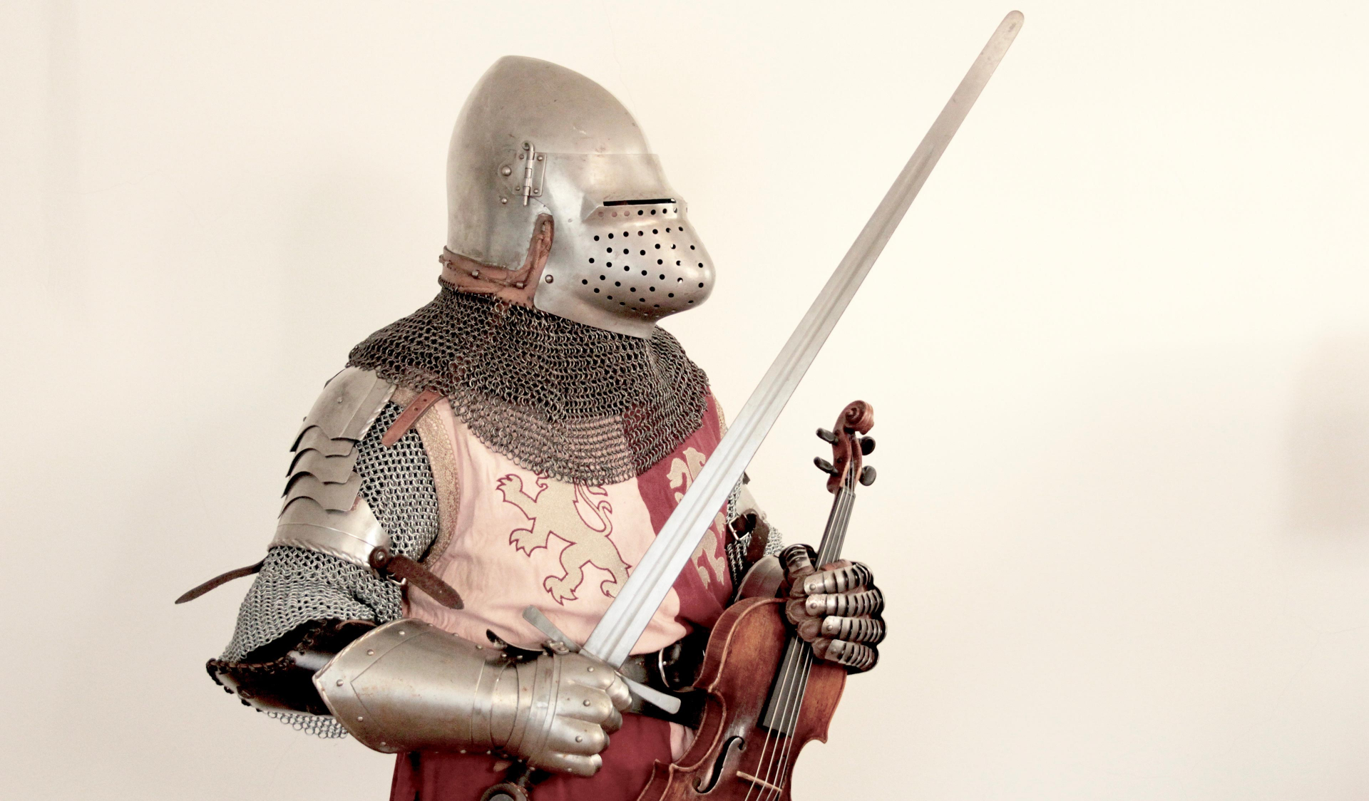 A knight's armor with a violin and a sword