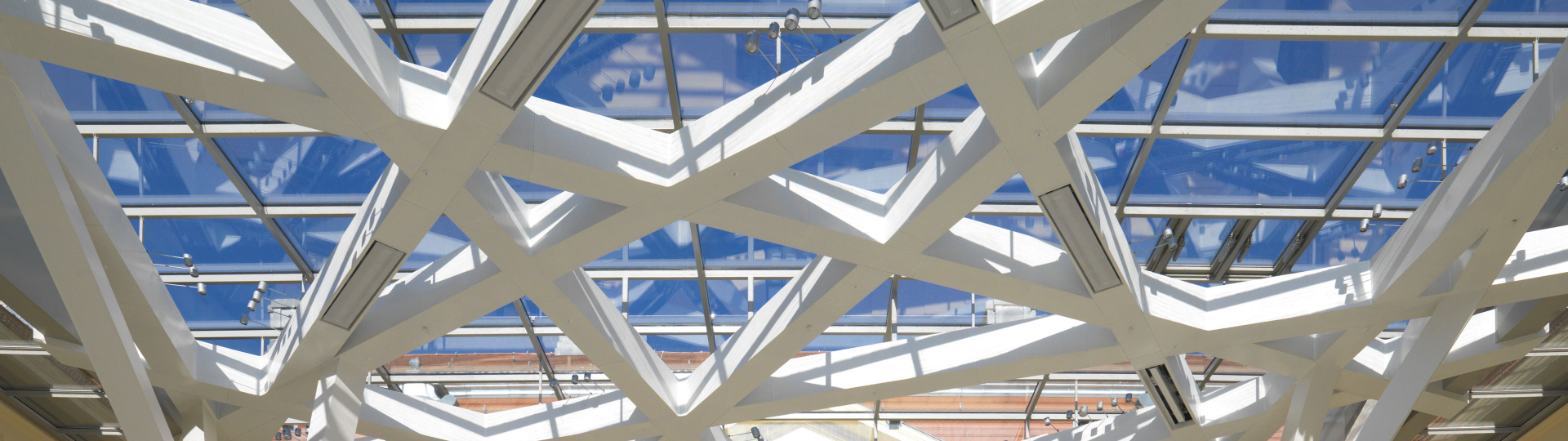 Ceiling of the Glass Courtyard against the blue sky