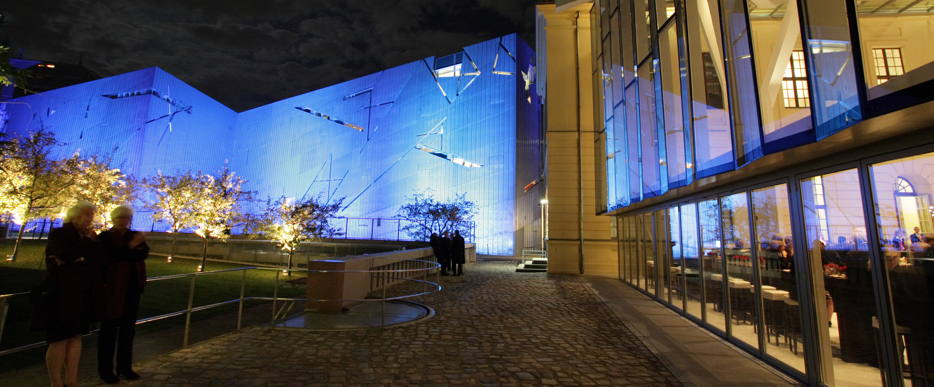 Libeskind Building and the Glass Courtyard at night (illuminated by blue light)
