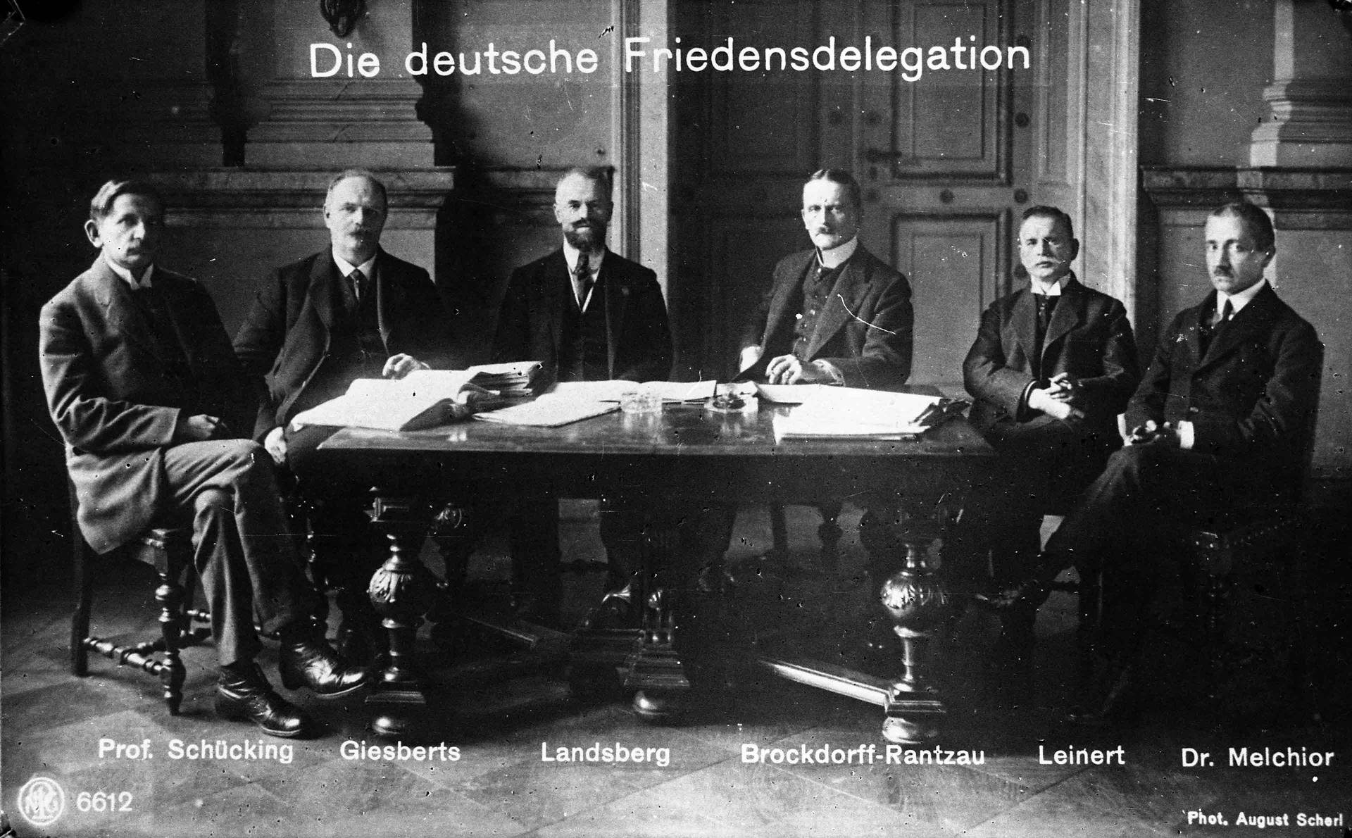 Group picture of the German peace delegation at Versailles around a table