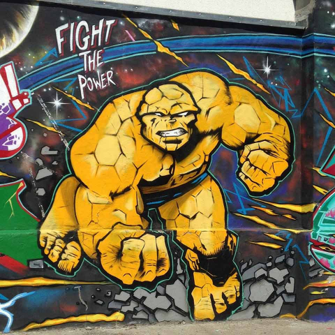 Graffiti with yellow action figure